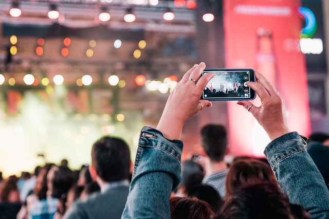 Fan Taking a Smartphone Snap at a Concert
