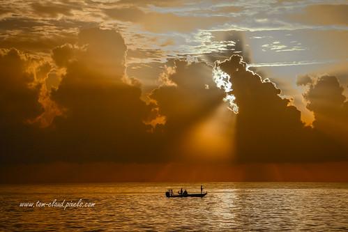 sun sunrise clouds cloudy weatherrays sunrays water ocean atlantic atlanticocean seascape shore beach hutchinsonisland boat fishing fisherman nature mothernature stuart florida outdoors usa