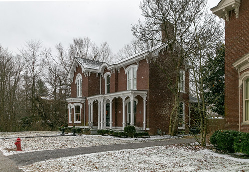house dwelling residence historic duncan paris kentucky unitedstatesofamerica us twostory gabledell ornate italianate polygonalbay cornice brackets hoodmolds segmentalarched 11windows scrollwork driveway bushes shrubbery trees bourboncounty ca1880