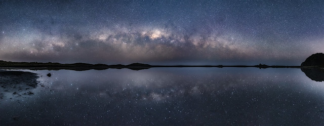 Milky way reflections Panorama at Karekare beach