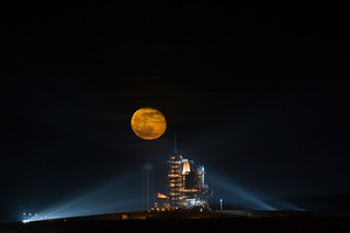 The moon is seen rising behind the Space Shuttle Endeavour on pad 39A. Original from NASA. Digitally enhanced by rawpixel.