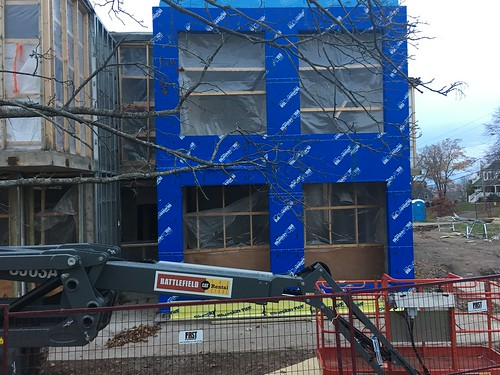 Exterior insulation being applied.