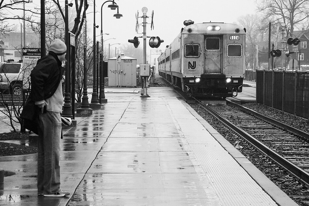 Waiting in the Rain | A man waits on the platform at Rutherf… | Flickr