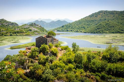karuc montene montenegro lake water house picturesque trees mountains landscape sky boat bay nikon d5100
