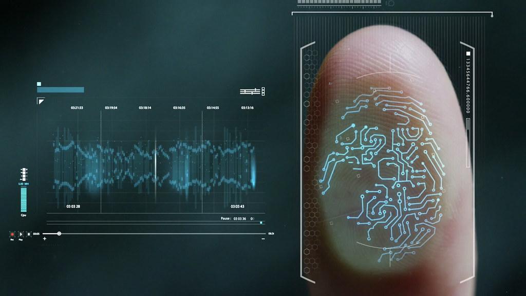 A futuristic circuit superimposed over a thumb