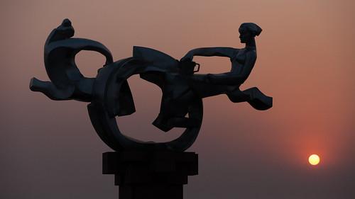 yixing wuxi jiangsu china prc sunrise dawn softlight silhouette sculpture artwork public park orange sun