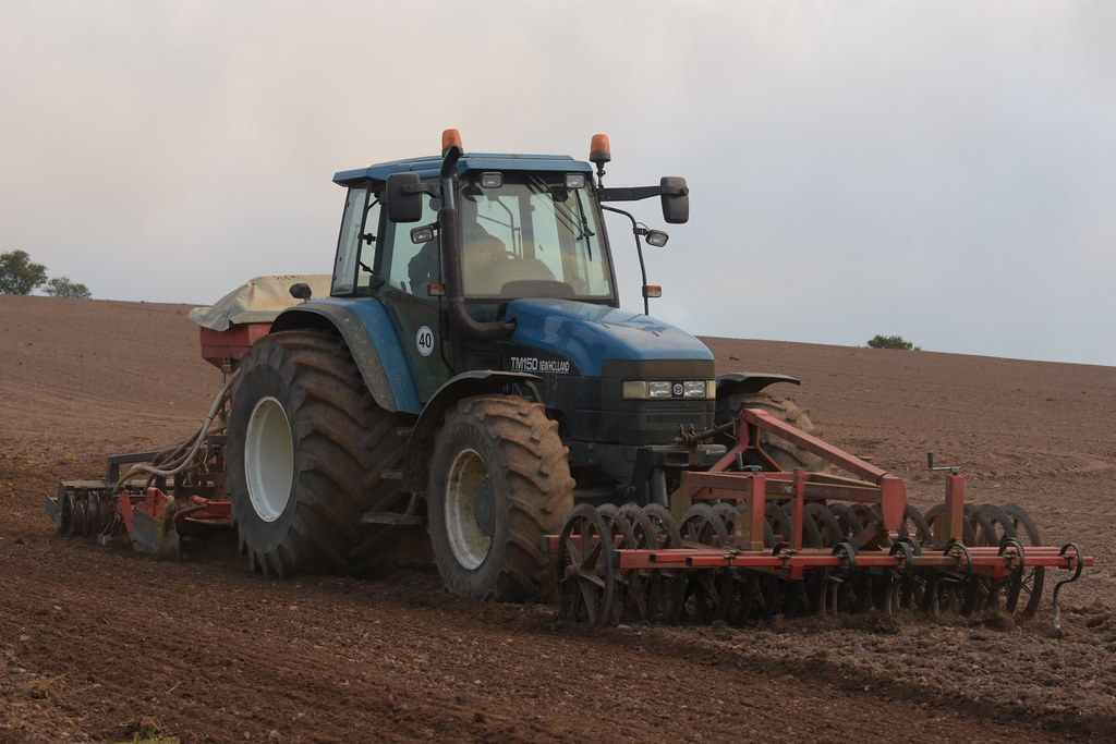 New Holland TM150 Tractor with an Accord Sacompactor Seed … | Flickr