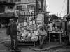 Street live in Lagos, Nigeria - newspaper stand by Martin Kukielka