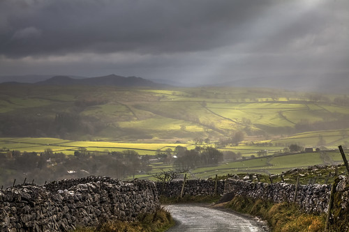 yorskshire dales yorkshiredales national park nationalpark landscape landschaft outdoors natur nature sun rays rain clouds cloudy wall drystone drystonewall malham united kingdom unitedkingdom uk gb greatbritain britain europe scenic green road track trees hills village sheep eos canon canon5d light