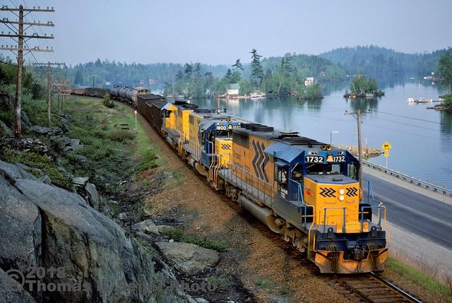 ONTARIO NORTHLAND TRAIN #113 ROARS PAST RUNNING TRACK SPEED HEADED NORTH - TEMAGAMI, ONTARIO - MAY 24, 1980