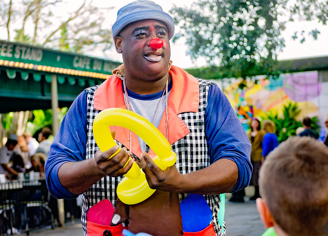 Man makes balloon animals for tourists at Café Du Monde in the French Market in New Orleans Louisana