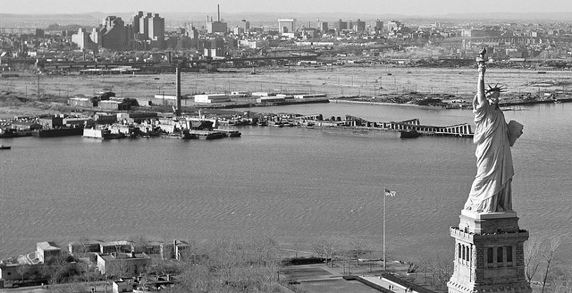 The pre-Liberty State Park shoreline with abandoned remnants of the Central Railroad of New Jersey train yards, the old Medical Center, the Journal Square PATH building and the Turnpike Extension hovering in the right background. Jersey City. March 1979.