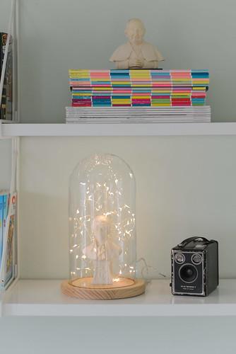 Shelfie with fairy lights in a glass dome | by jutta / kootut murut