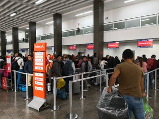 Queues for check-in | by A. Wee