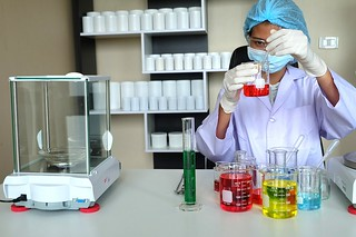 researching in laboratory   by sarojcollage