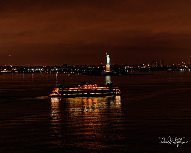 Staten Island Ferry Pass In Front Of Statue of Liberty