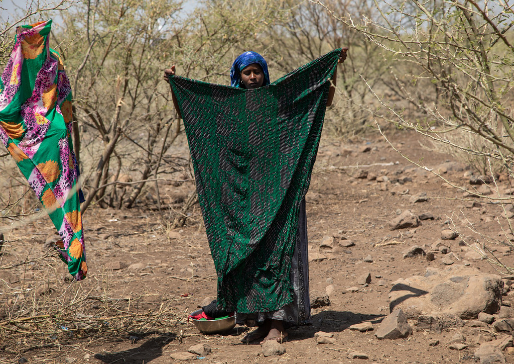 Somali woman drying clothes in an arid area, Afar Region, … | Flickr