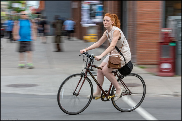 Red Hair Rider on bank Street