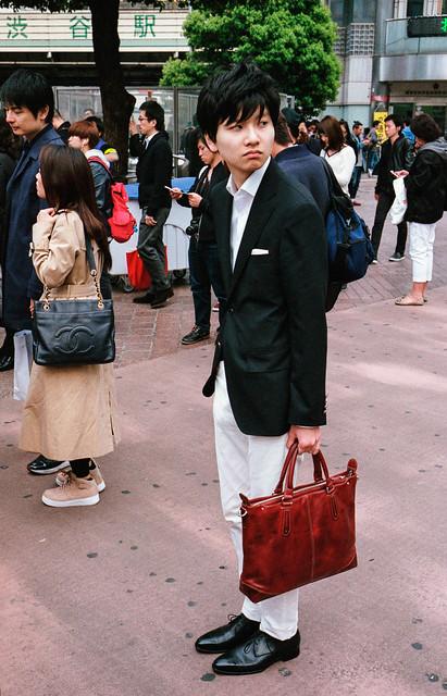 Black jacket, brown attaché case