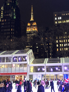 Picture Taken Looking South In Bryant Park In New York City. The Empire State Building Can Be Seen In The Background Lit In Honor Of The In Celebration Of The Simpsons' 30th Anniversary (Yellow/Yellow/Yellow). Photo Taken On Monday December 17, 2018