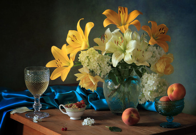 Still-life with lilies and a glass of wine