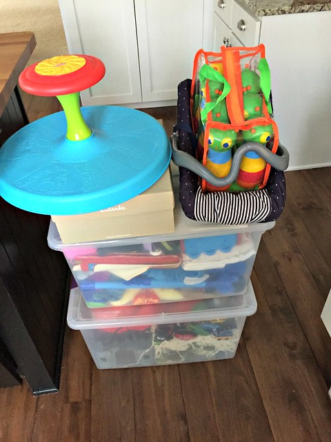 tubs of toys to sell or purge