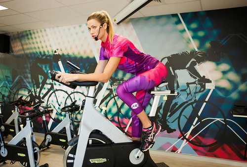 Woman Riding Exercise Bike | by SportsFanaticAustralia