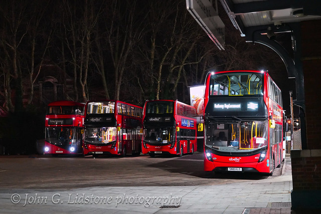 A cluster of Abellio London vehicles including New Routemaster LT712 and Enviro400 MMCs 2587, 2616 and 2613 framed by Southend Victoria Station, on Greater Anglia Rail Replacement