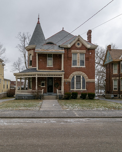 house dwelling residence historic paris kentucky unitedstatesofamerica us queenanne romanesque sidewalk bushes hedges shrubbery street bourboncounty twostory brick porch turret stonework polychromatic stringcourse roundarched picturewindow chimney 11windows johnmcclintock 1889