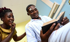 September – Desire sees his children's faces and reads his bible after sight-restoring surgery