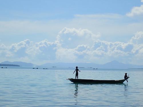 Paddling with the foot - Bajau Laut Boys on Fishing Trip Nearby Labuan Haji, Semporna, Malaysia | by AquaticApe