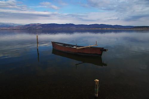 boat lake water sky clouds mountain macedonia nord