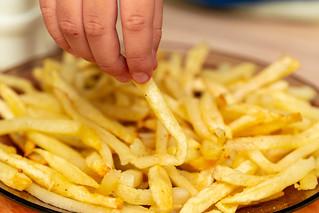 French fries in a plate | by wuestenigel