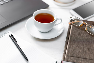 Business table background with a Cup of coffee | by wuestenigel