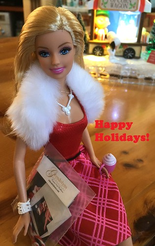 Barbie's pretty happy with her gift bag and greeting card props that came with Gwen's holiday card!
