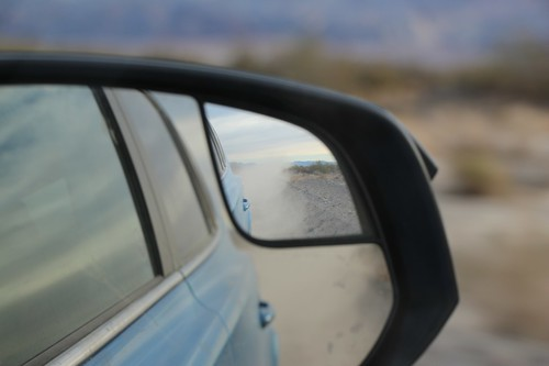 1101 Dust clouds in our rear-view mirror as we blast along the easy-driving West Side Road in Death Valley   by _JFR_