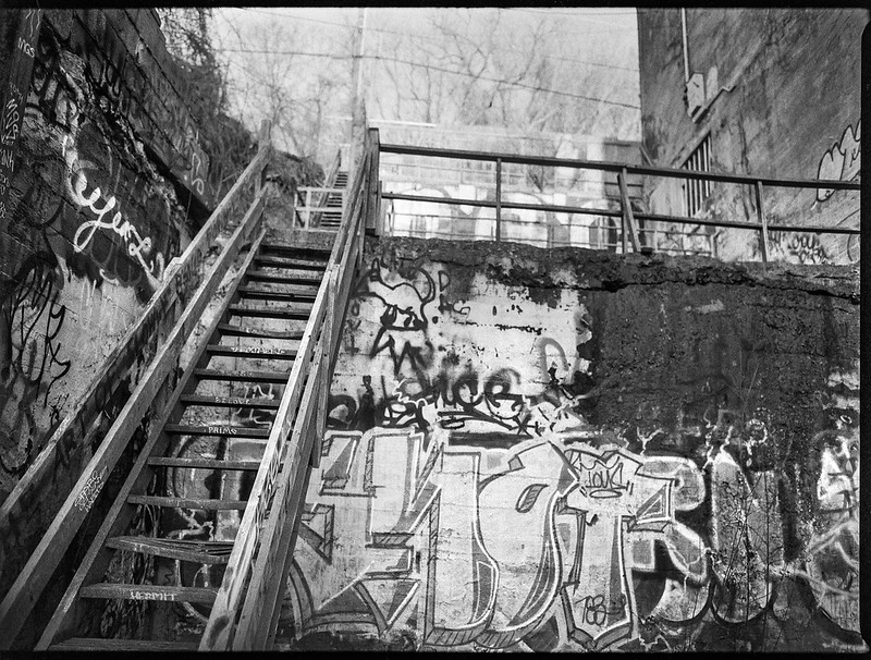 looking up, stairway, graffitied walls, River District, Ashevile, North Carolina, Mamiya 645 Pro, mamiya sekor 45mm f-2.8, Bergger Pancro 400, Ilford Ilfosol 3 developer, 1.5.19