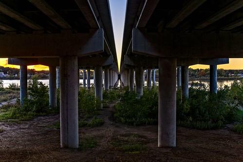 d610 arkansasriver bridge sunset sunsetlight foliage dirt columns sky ononesoftware on1photoraw2018 tamron35f18vc