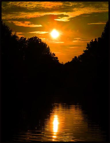 sunset water reflection sundown evening