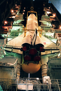 Lights frame the orbiter Endeavour as it is lowered onto the platform for mating with the external tank and solid rocket boosters. Original from NASA . Digitally enhanced by rawpixel.