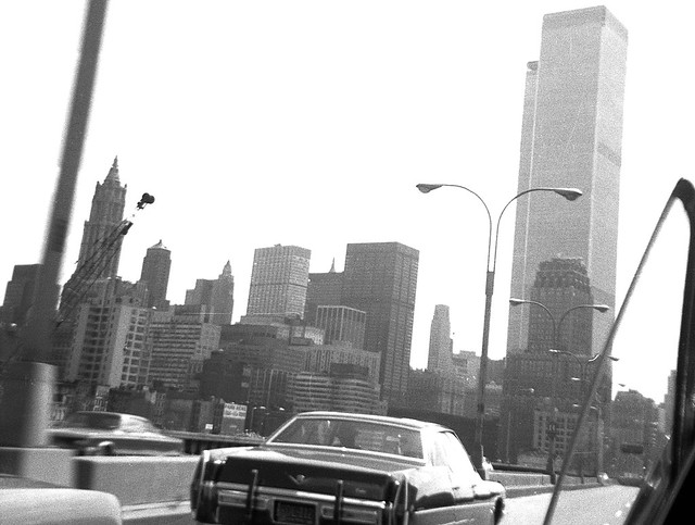 Zooming along the West Side Highway in dad's 1965 Pontiac Bonneville looking to the still-unfinished World Trade Center and the Lower Manhattan skyline. I cranked down the rear window, quickly pointed the camera and got the shot. New York. Aug 1972