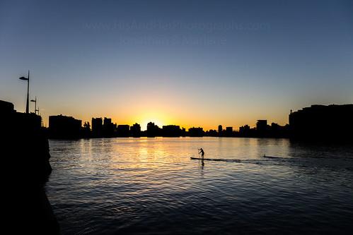puertorico condado sanjuan san juan puerto rico silhouette silhouettes water lagoon buildings atlantic ocean paddle board paddleboarding man exercise beautiful bridge colors colorful pr boricua color sun sunrise clearsky