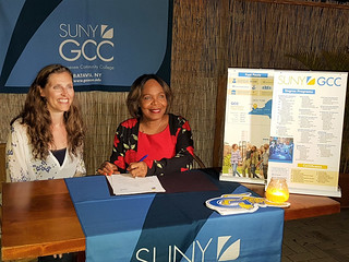 Sun, 11/11/2018 - 17:06 - GCC's Kamilla Kabel joining Dr. Marilyn Alcalá-Wallé as she signs the MOU