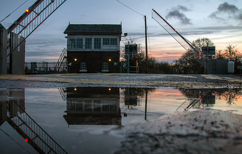 welton crossingbox signalbox levelcrossing barriers sunset dusk water puddle reflection railways trains sydyoung sydpix