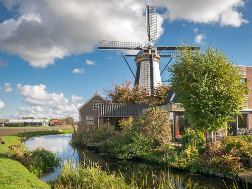 mill windmill scenic holland netherlands water canal sky clouds