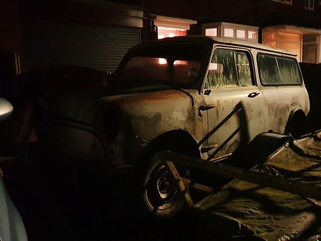 A night time photo of classic rusty Mini Estate.