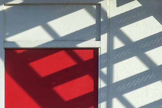 Shadowplay on a red door
