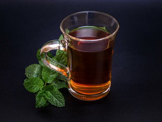 Peppermint tea made of fresh mint on dark background | by Ivan Radic