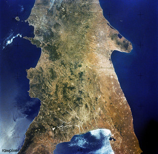 This rare cloud-free view of southern Italy shows almost all of the famous `boot' configuration of the peninsula up to just north of Naples and Mount Vesuvius. Original from NASA. Digitally enhanced by rawpixel.