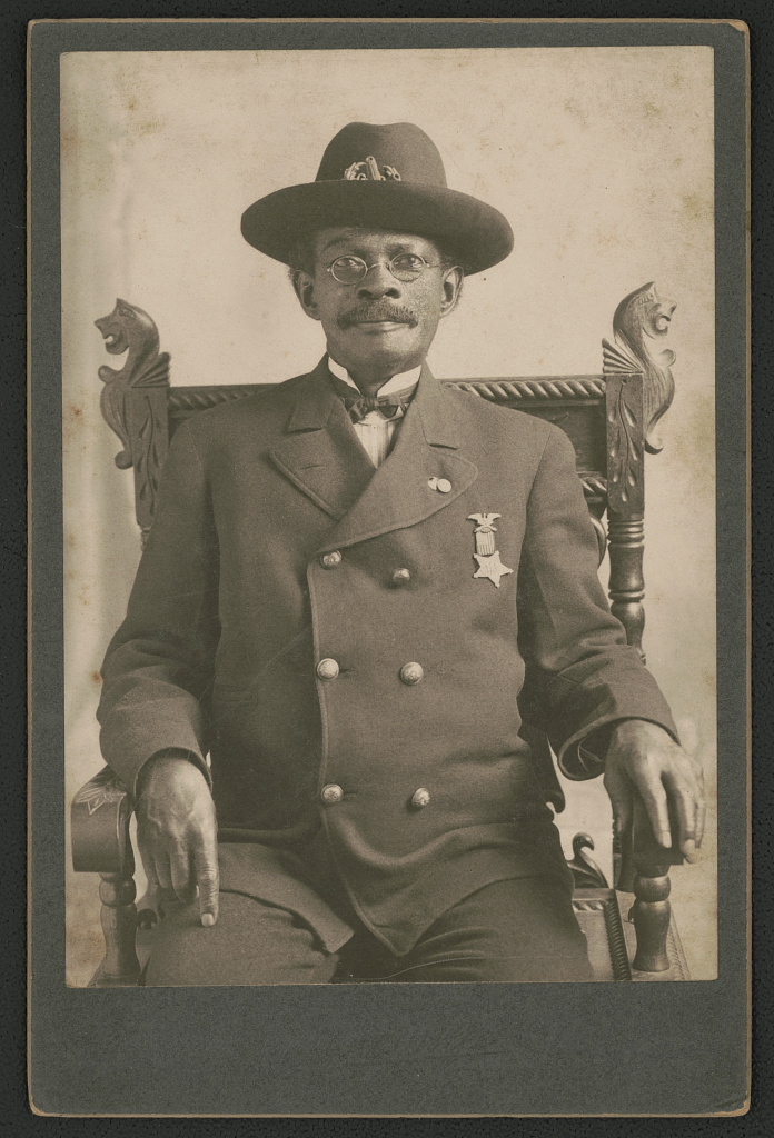 [Civil War veteran John W. Pollard, who served under the name of Private Jackson Ridgway in the 83rd U.S. Colored Troops, in Grand Army of the Republic uniform with medal] (LOC)